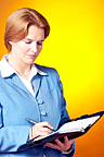 woman using a day planner book
