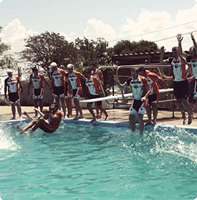 Bike MS participants jumping into a pool