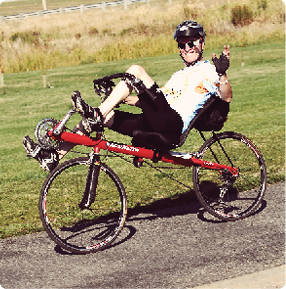 man riding recumbent bicycle