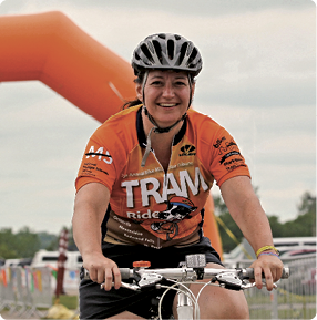Woman biking wearing biker's jersey